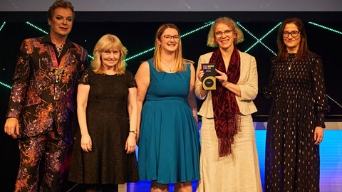Image of staff members receiving awards at the Times Higher Education Awards.