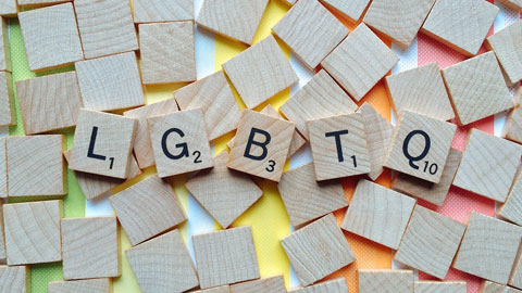 Image of scrabble tiles spelling LGBTQ.