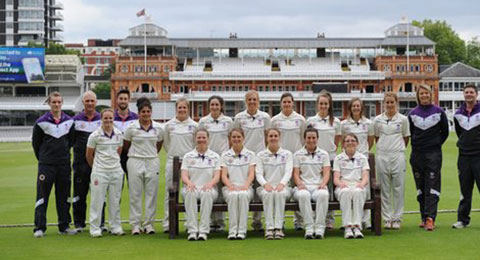 A photo of women who play cricket